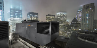 Industrial generator on building roof top in city